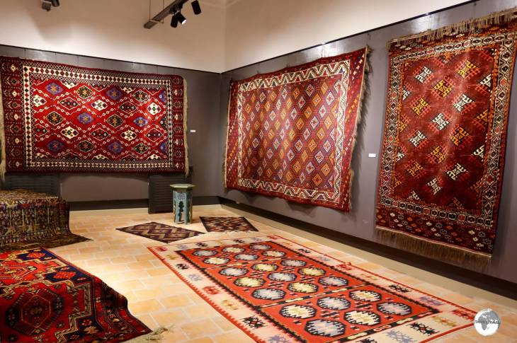 Uzbekistan Travel Guide: The carpet gallery at the Nurullaboy Saroyi museum.