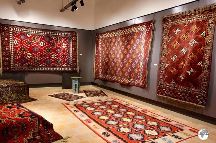 Uzbekistan Travel Guide: The carpet gallery at the Nurullaboy Saroyi museum.