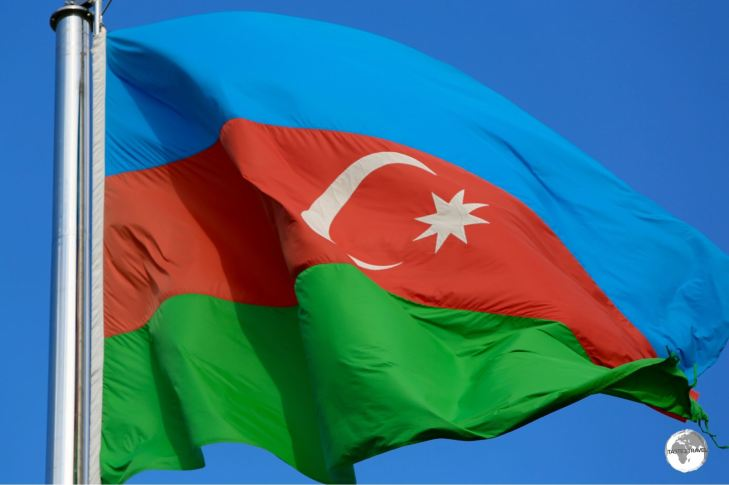 The flag of Azerbaijan flying on the waterfront in Baku.