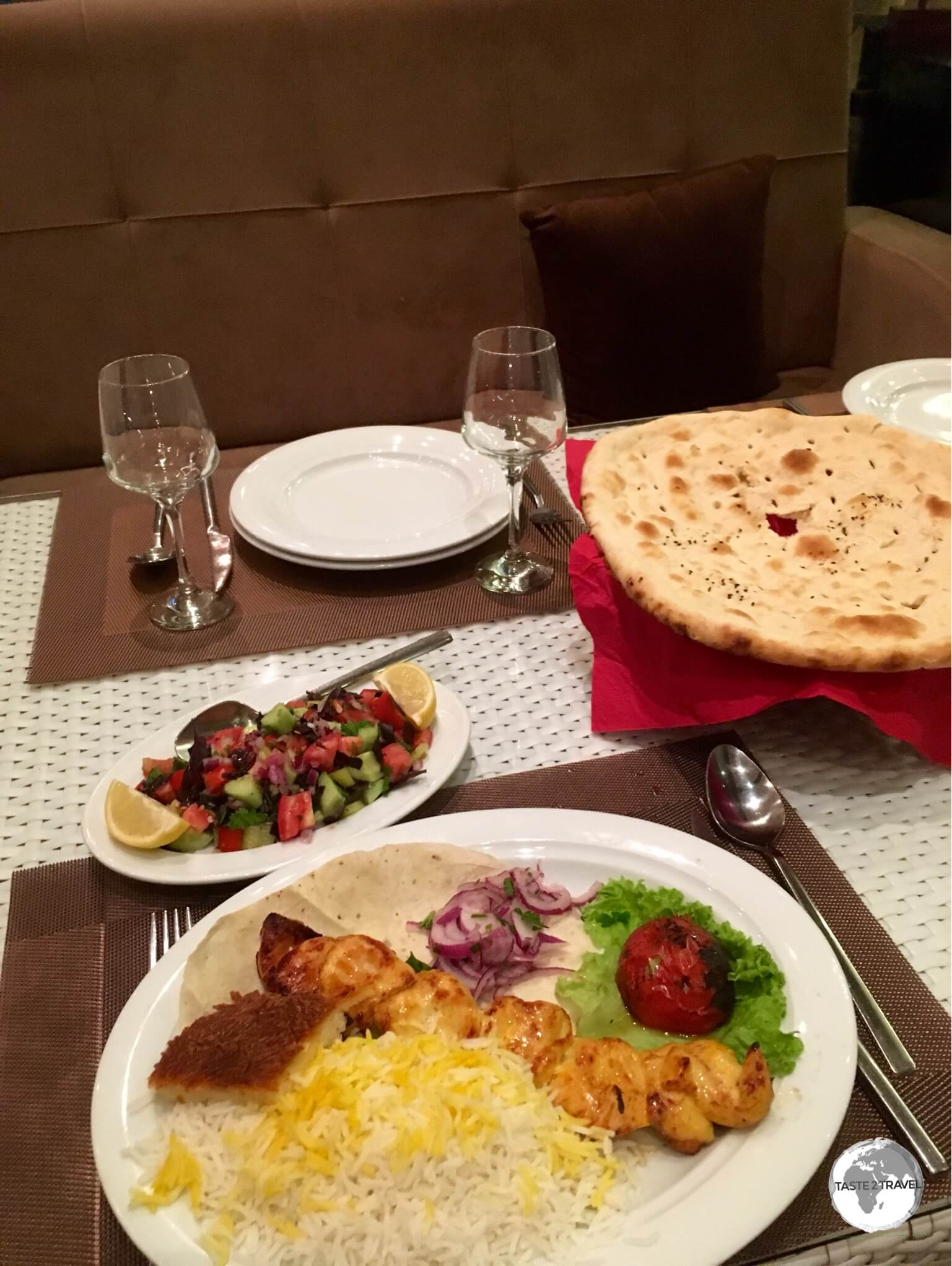 A typical meal in Azerbaijan – BBQ'd meat, salad, bread and some rice.