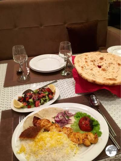 A typical meal in Azerbaijan - BBQ'd meat, salad, bread and some rice.