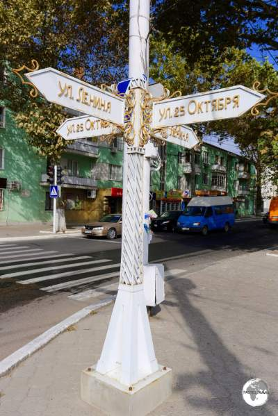 An ornate street sign in Tiraspol at the intersection of Lenin street and 25th of October street.