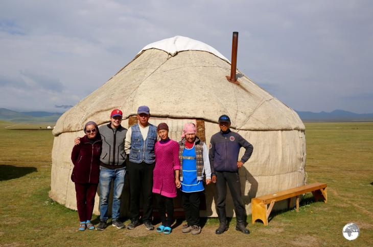 My host family, and their adopted US Peace Corps volunteer, outside one of their yurts, on lake Son-Kul.