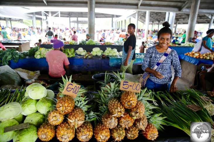 Juicy and sweet, pineapples at Madang market cost just K5 (USD$1.47).