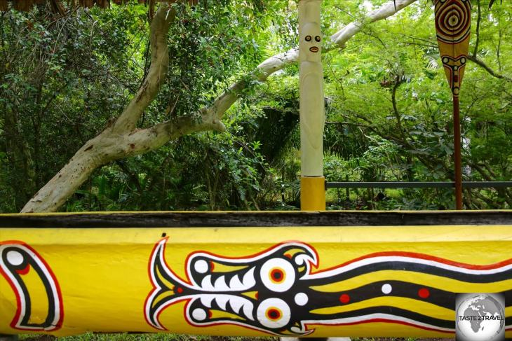 A colourful, hand-carved, wooden canoe at the POM Nature Park.