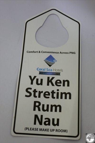 A Pidgin English hotel room service sign.