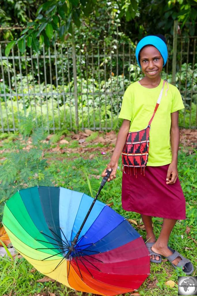 A young girl in Lae posing for the camera.