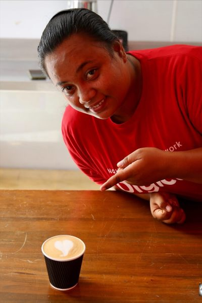 The multi-talented Elizabeth, Barista and Digicel phone specialist at the Container café on Nauru.igicel phone specialist.