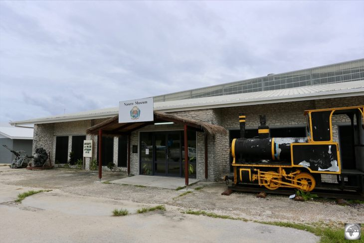 A view of the Naoero Museum with one of the locomotives from the old phosphate railway on the right. The railway was built by the Pacific Phosphate Company in 1907.