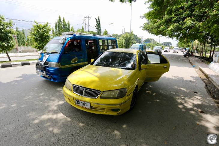 A taxi and mikrolet, the main forms of transport in Dili.