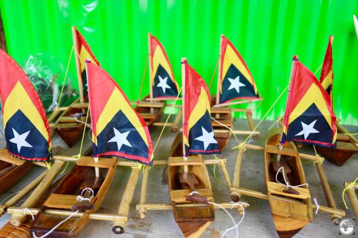Souvenir model boats for sale at the Tais market, with sails made from tiny Timor-Leste flags.
