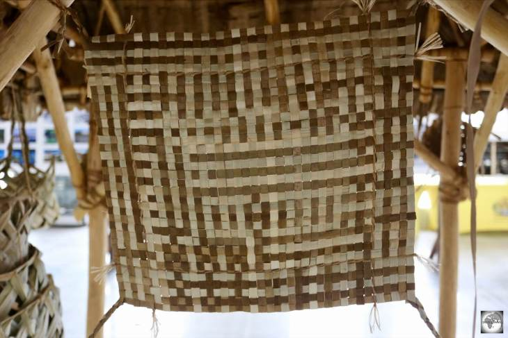 A close-up view of a traditional 'Tribal Mat'. About the size of a place-mat, these were worn around the waist by woman with the distinct pattern indicating their tribe.