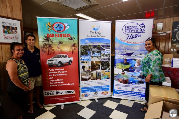 The wonderful staff at Capelle and Partners showing off their new banner ads which feature their car rental, accommodation and fishing charter businesses.