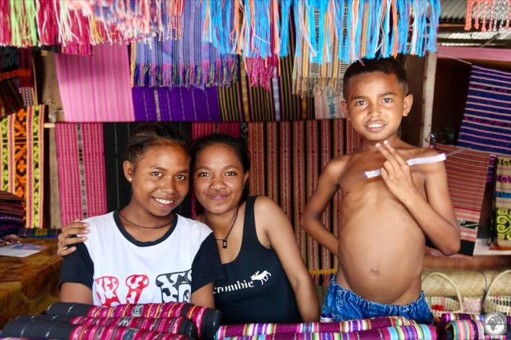 Friendly Timorese youth selling traditional Tais cloth in the Tais market in central Dili.