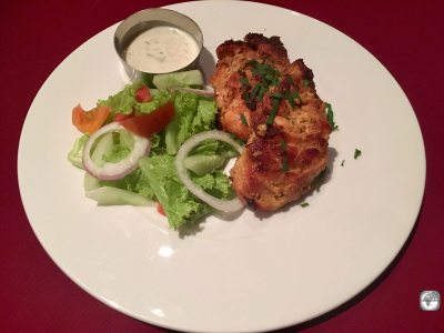 Chicken tandoori, served with salad and Raita.
