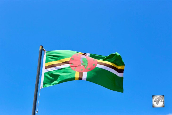 The flag of Dominica flying in Roseau.
