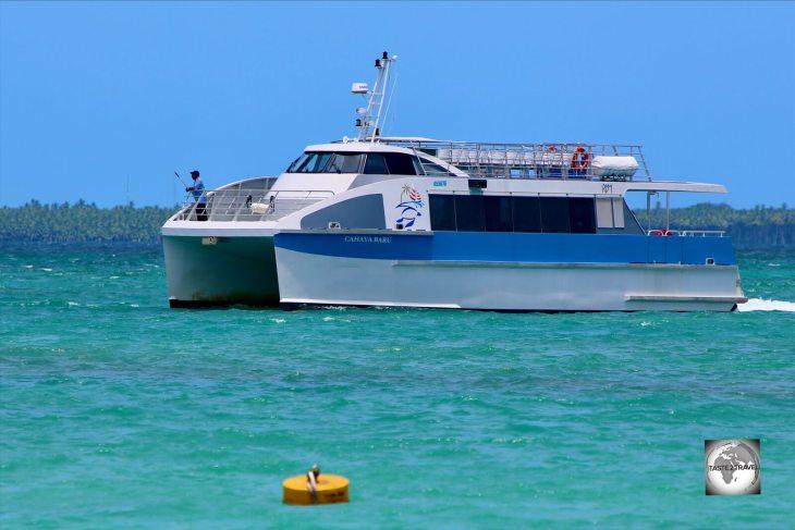 The <i>Cahaya Baru</i> ferry arriving at Home Island.