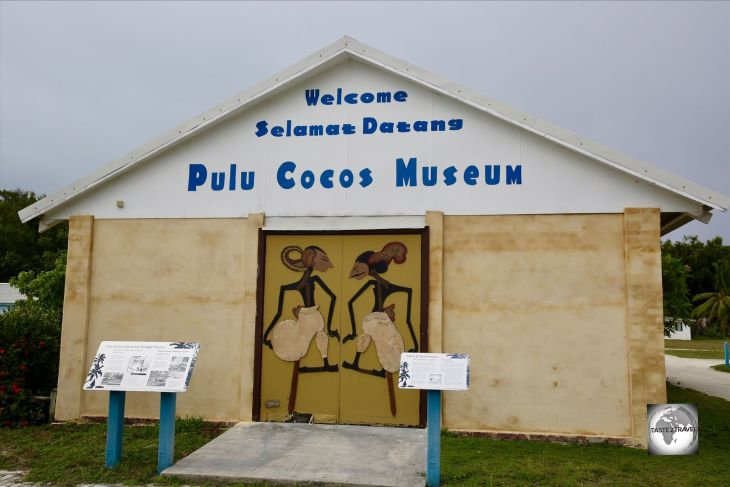 <i>Wayang Kulit</i> puppets adorn the doors of the <i>Pulu Cocos Museum</i> on Home Island Museum.