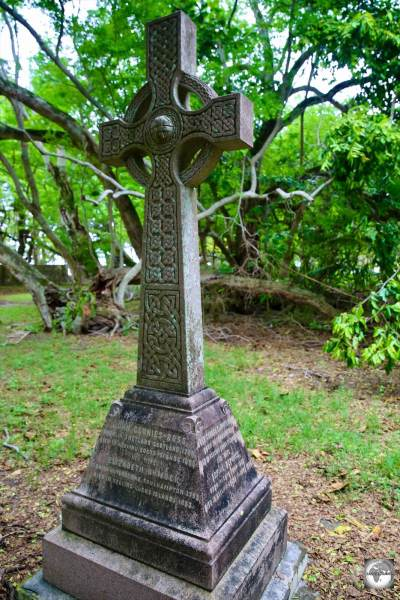 A Celtic cross, in the garden at Oceania House, marks the final resting place of many members of the Clunies-Ross family.