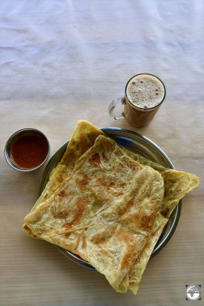 The perfect Malaysian breakfast at Halal café - Teh Tarek and Roti Telur.