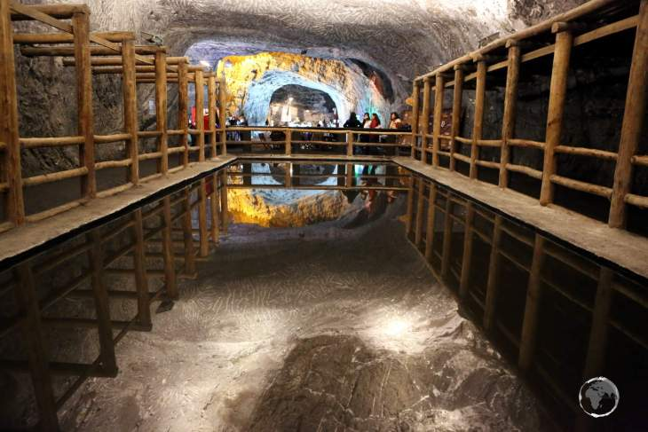 A pool of water at the Salt Cathedral of Zipaquirá forms a mirror, perfectly reflecting the ceiling above.