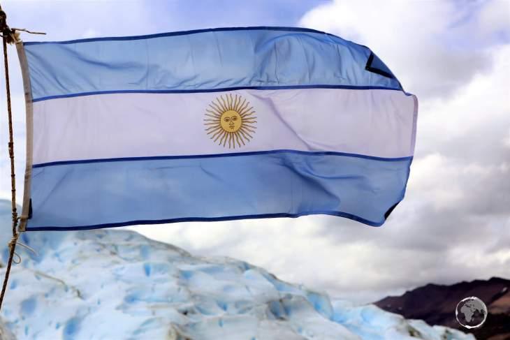 The flag of Argentina flying on the Perito Moreno Glacier.