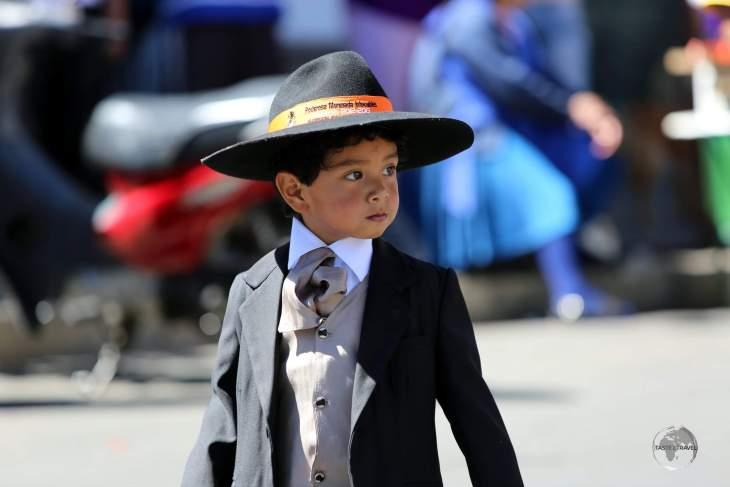 Men (and boys) who participate in the 'Fiesta de la Virgen de Guadalupe' wear formal attire such as hats, suits, tuxedos, ties, leather shoes etc.