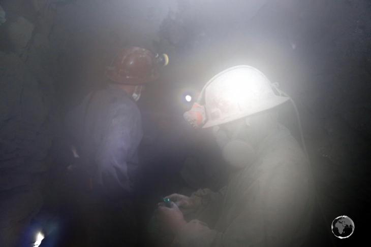 Dust settles after a dynamite explosion. Due to poor worker conditions and a lack of OH&S practices, many of the miners contract silicosis and have a life expectancy of around 40 years.