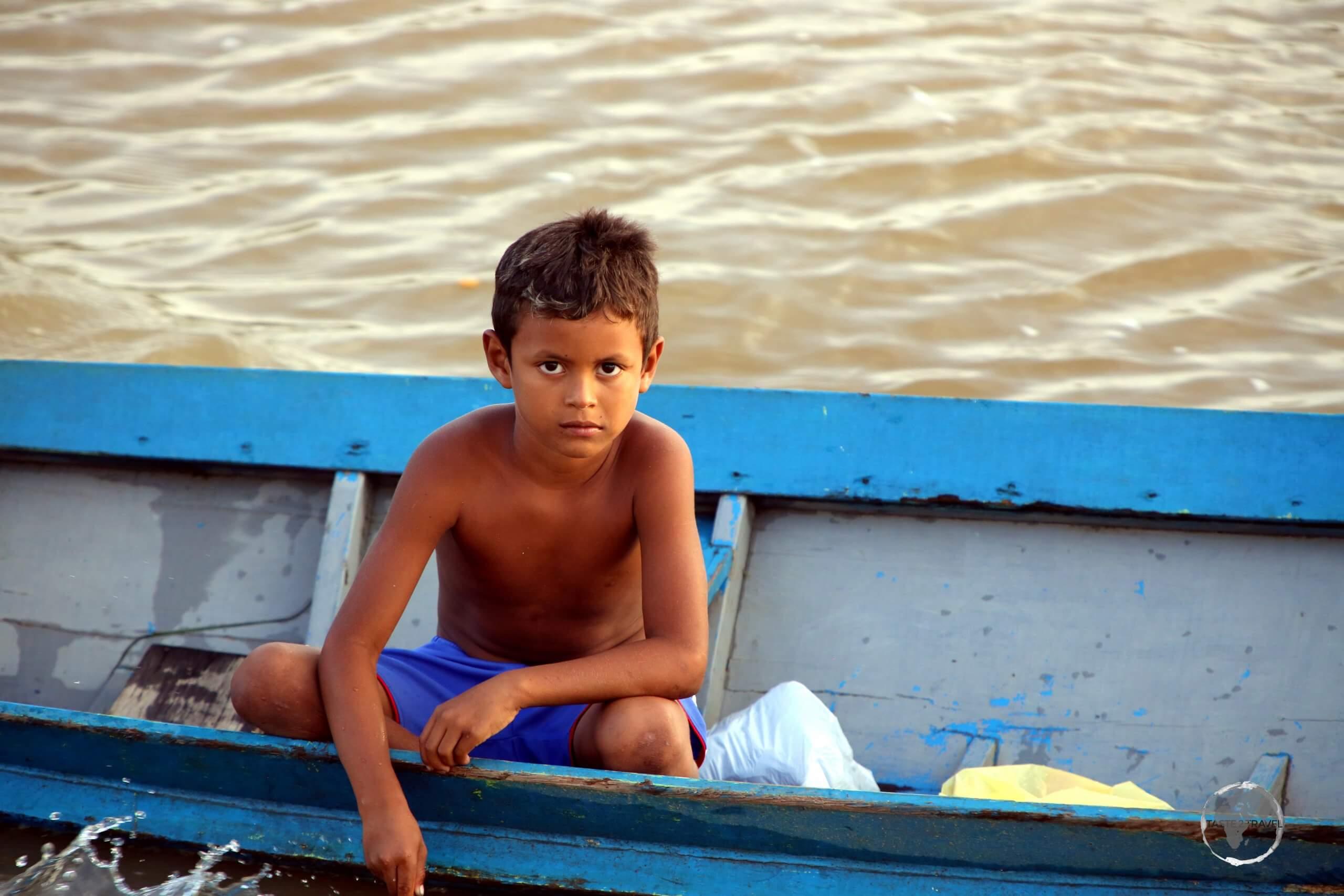 Young boy on the Amazon river near Macapá, Brazil.