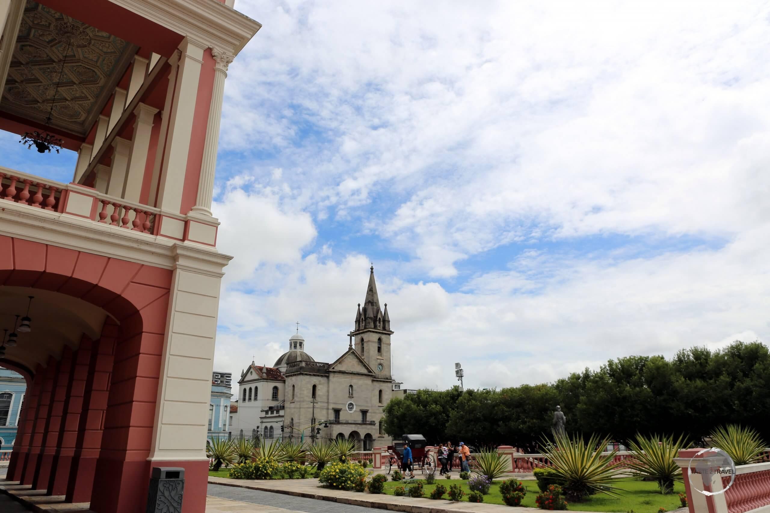 A view of the Amazon theatre, the Largo de São Sebastião (plaza) and the Escritório Paroquial de São Sebastião (church) in downtown Manaus.