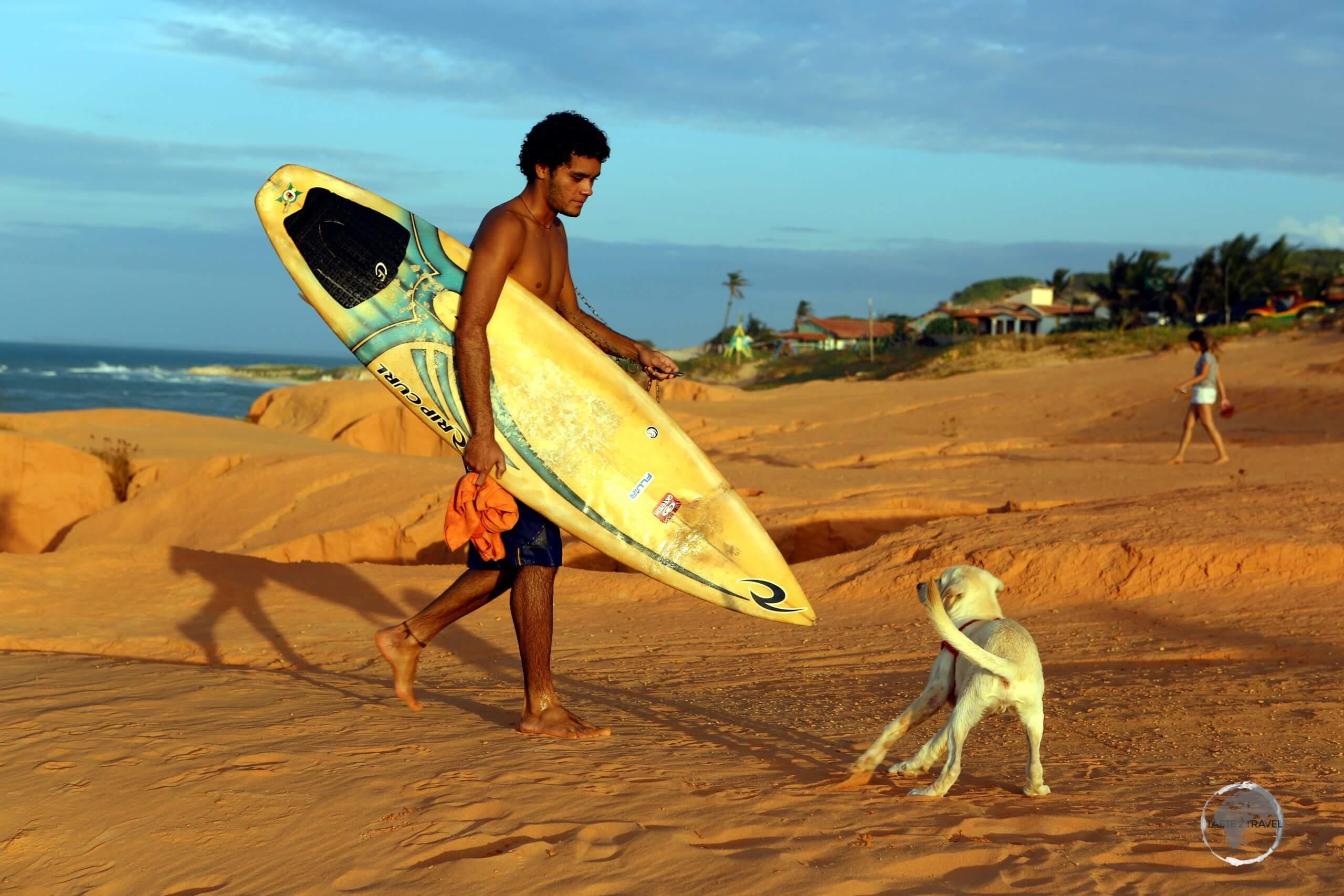 A surfer in Canoa Quebrada, Ceará state, Brazil.