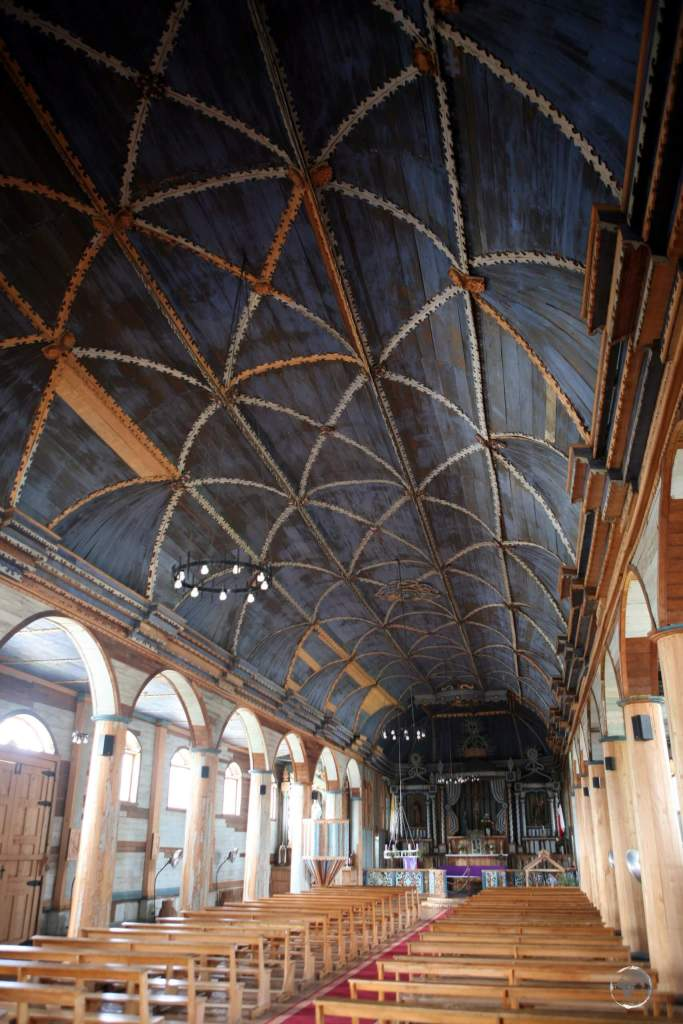 A view of the beautiful nave of the Church of Santa María de Loreto de Achao, which is built entirely from wood.