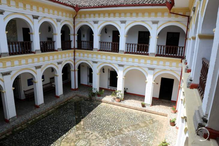 The ornate courtyard of the 'Museo Arte Religioso' (Religious Art Museum) in Popayán, Colombia.