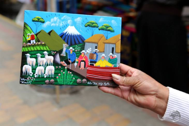 Colourful artworks, depicting typical Andean scenes, are popular souvenirs at the weekly craft market in Otavalo, Ecuador.