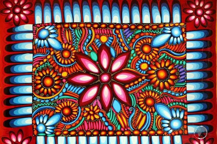 A colourfully painted wooden platter at the Otavalo craft market.