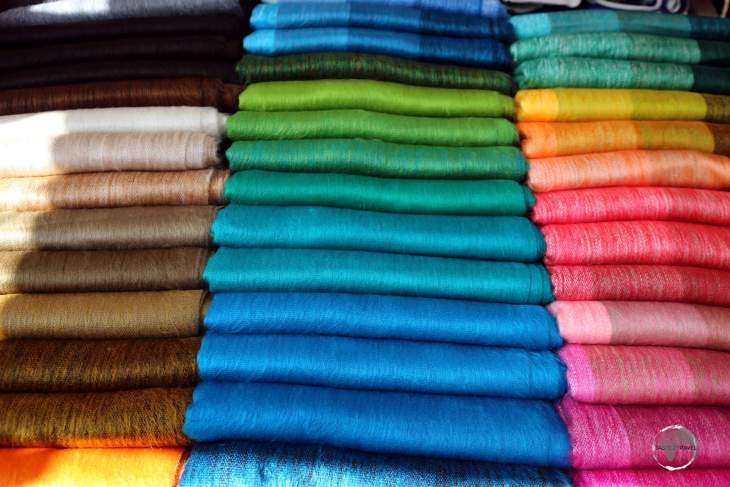 Colourful Andean fabrics are a popular souvenir item at the weekly handicraft market in Otavalo, Ecuador.