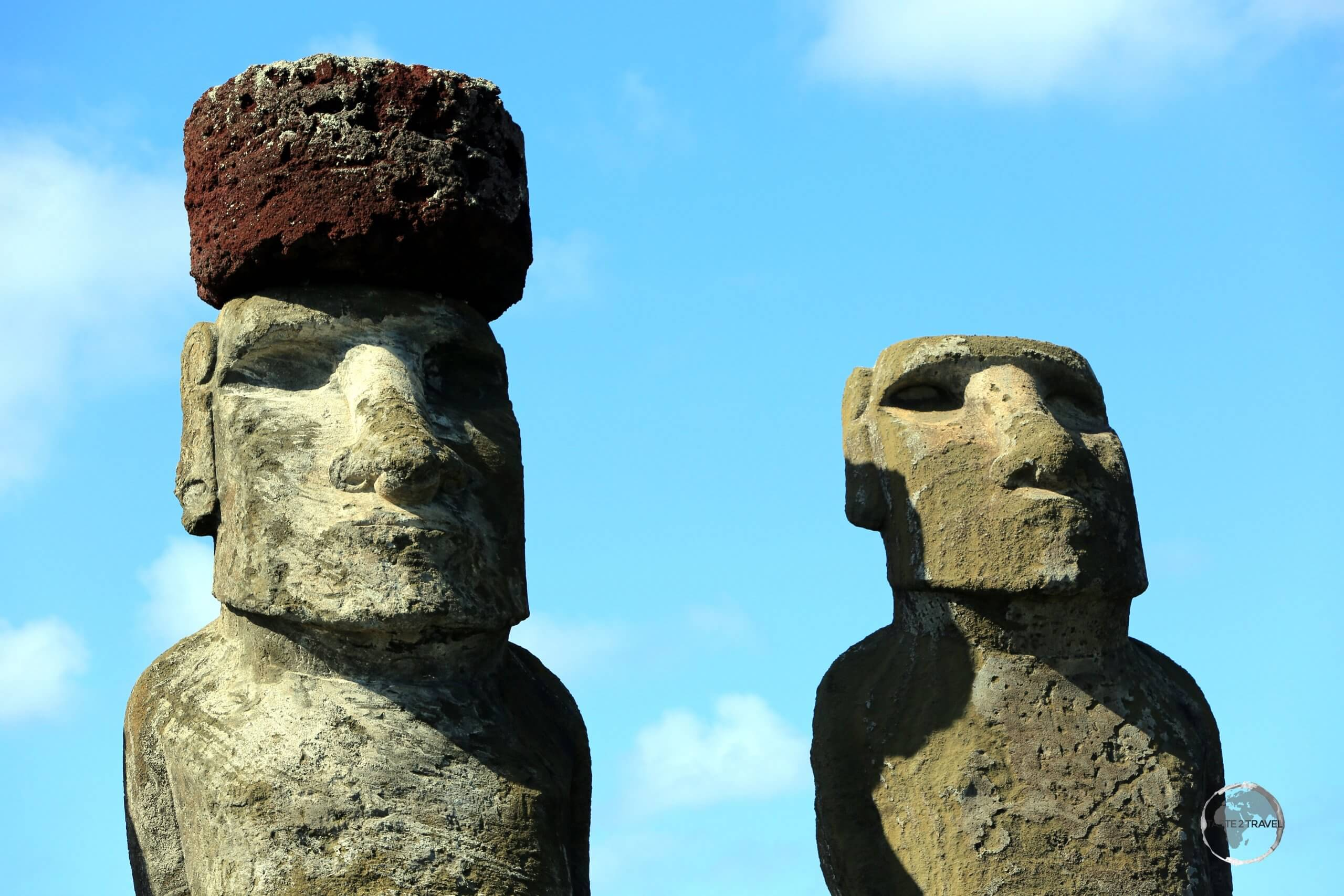 A moai at Ahu Tongariki wears a Pukao, a hat-like structure, or topknot, all of which were carved from a light-red volcanic scoria, which was quarried from a single source at Puna Pau.