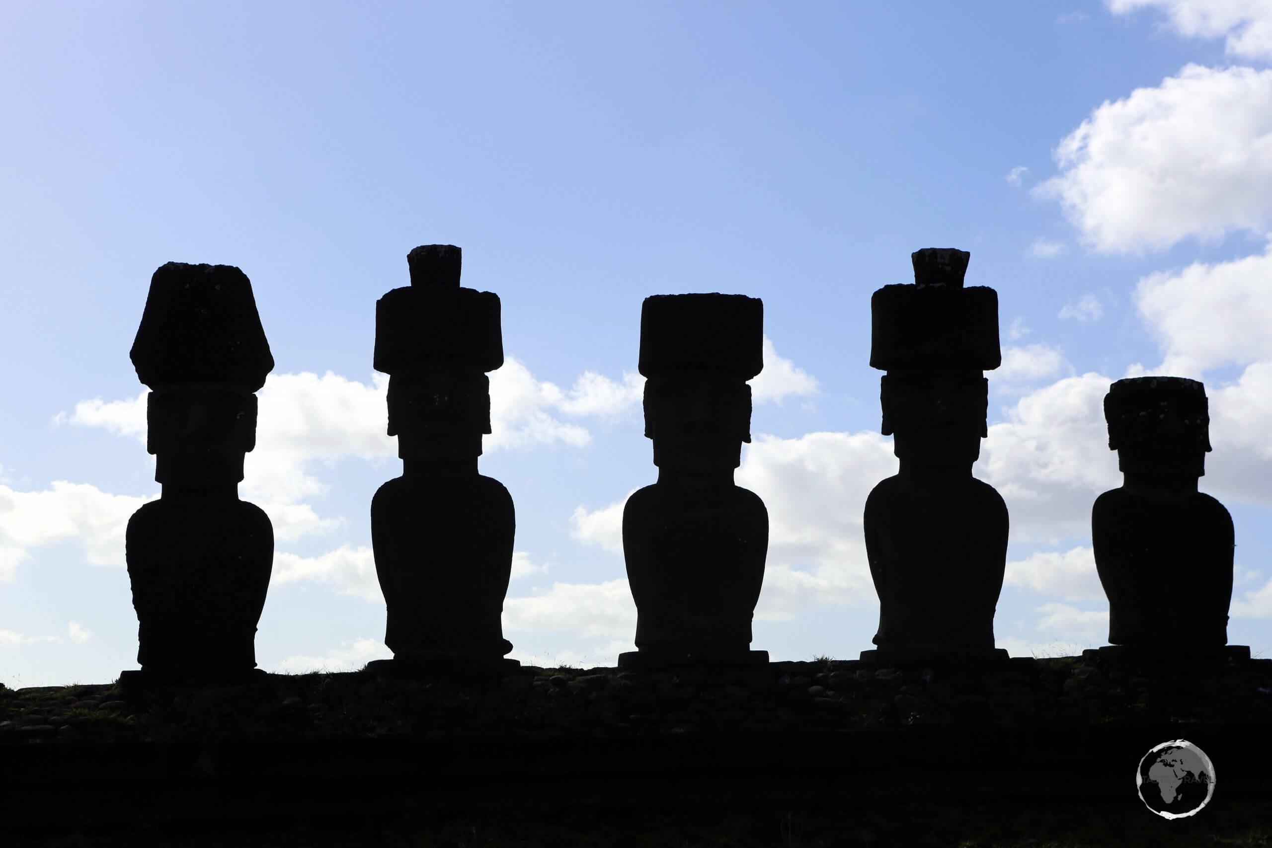 A silhouetted view of the moai of Ahu Nau Nau.