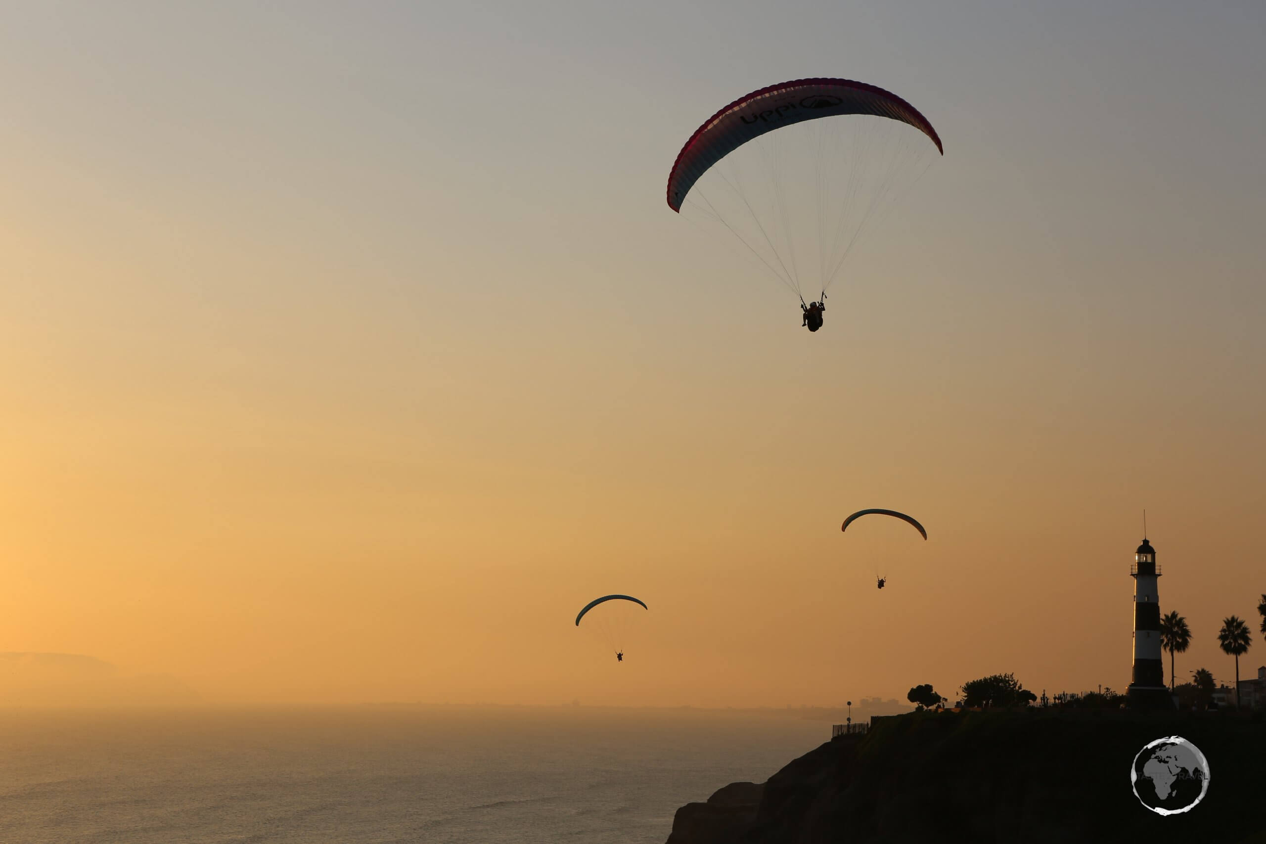 Paragliders over the Pacific Ocean at sunset, in Miraflores, an upscale neighbourhood of Lima, the capital of Peru.