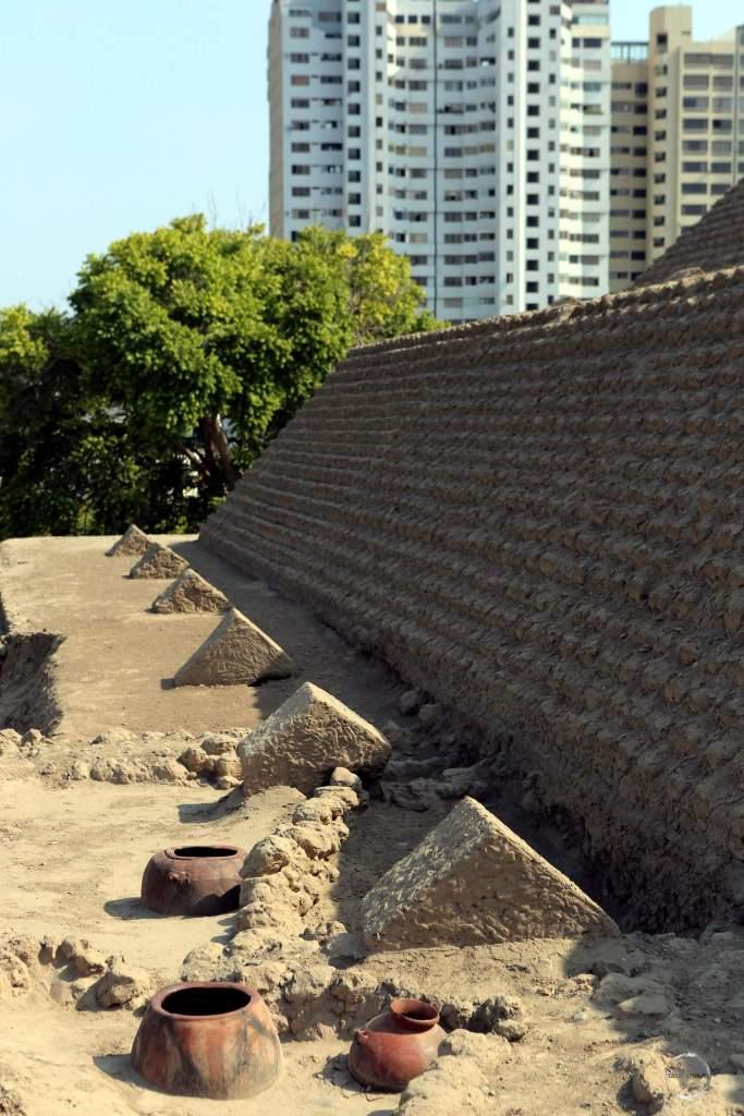The pre-Columbian adobe Huaca Huallamarca pyramid is a startling sight, rising among the modern high-rises of Lima's San Isidro district.