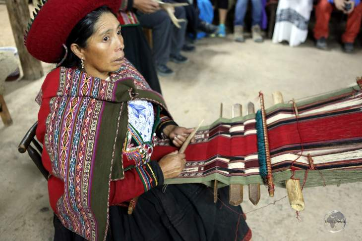 A Quechua weaver at the 'Chinchero Centre for Traditional Culture' which is located in the Andean town of Chinchero (3,800 m/ 12,500 ft), 17 km north-west of Cusco.