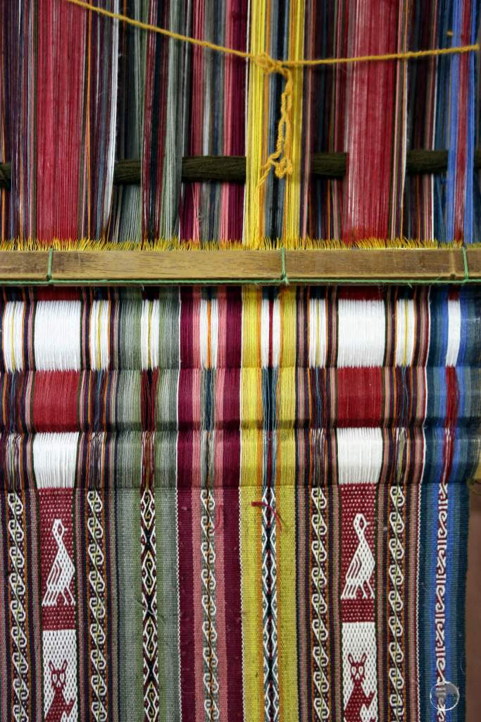 Andean weaving, seen here at Chinchero, is rich with innumerable Quechua symbols, patterns and animals.
