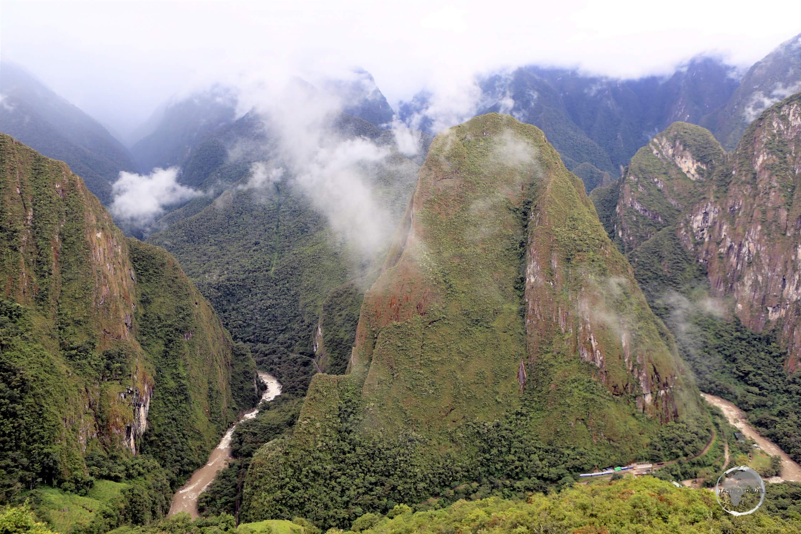Machu Picchu is dramatically situated on a ridge, high above the Urubamba River and the Sacred Valley, 80 km (50 mi) northwest of Cusco, Peru.