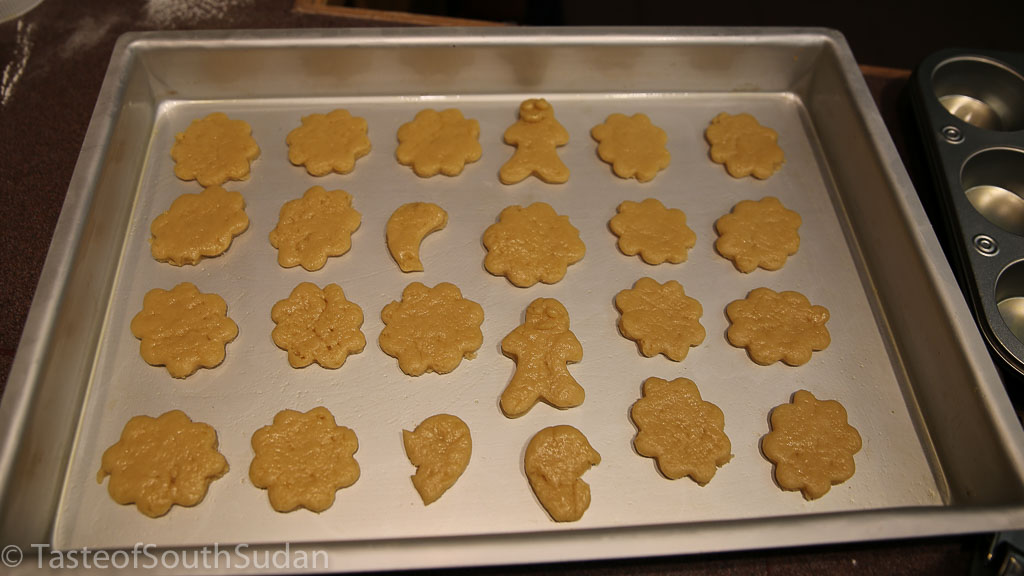 Christmas cookies dough in the shape of flowers, halfmoons and gingerbread man