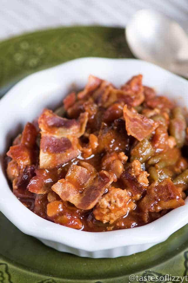 Throw this Slow Cooker Sausage Baked Bean Casserole together in the morning and forget it until your picnic. It's packed with bacon and 3 kinds of beans.