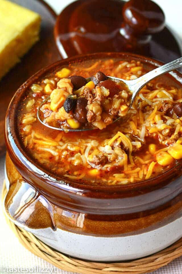 This Beefy Mexican Rice Soup is a hearty mixture of beef, rice, beans and corn. Your favorite burrito flavors...in a soup recipe!