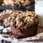 Soft, thick and rich s'more muffins are filled with chocolate, marshmallows and buttery graham cracker streusel. The secret to their moist texture is zucchini!