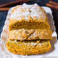 Easy pumpkin bread sliced with powdered sugar dusted on top