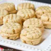Soft, peanut butter sandwich cookies filled with a sweet peanut butter cream. These bite-size cookies from Amish country are perfect for gift giving.