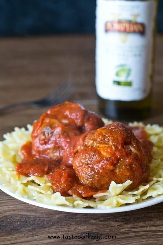 pasta dinner of mozzarella stuffed meatballs with pepperoni pizza sauce over farfalle pasta